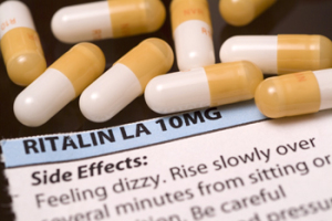 Ritalin pills and warning label.